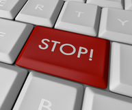 Red Stop button on keyboard. A red button reading stop on a white laptop keyboard Stock Photos