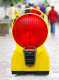 Red stop light on sidewalk Stock Image
