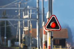 Red stop light at train station stock photo