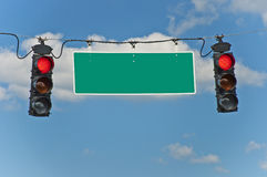Red Stop Lights With Blank Traffic Sign Stock Photo
