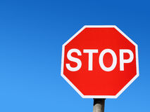 Red stop road sign and blue sky. Stock Images