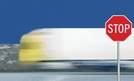 Red stop road sign, motion blurred truck vehicle traffic background, give way regulatory warning signage octagon, white octagonal stock images