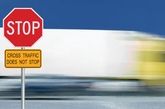 Red stop road sign, motion blurred truck vehicle traffic in background, regulatory warning signage octagon, white octagonal frame Royalty Free Stock Photos
