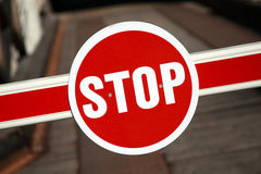 Red stop sign. Attached to a barrier to prevent traffic from entering a street Stock Images