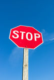 Red Stop Sign Against Blue Sky Stock Photography