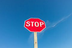Red Stop Sign Against Blue Sky Royalty Free Stock Photography