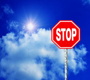 Red Stop Sign with Blue Sky Royalty Free Stock Image