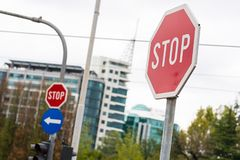 Red stop sign in a city Stock Images