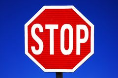 Red stop sign. With a clear blue sky background Royalty Free Stock Photos