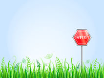 Red Stop Sign On Grass Meadow Royalty Free Stock Photos
