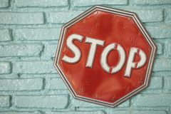 Stop sign on the green wall. Red stop sign On the green wall Stock Photography