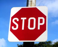 Red Stop Sign. A traffic sign that warns cars to stop to ensure road safety Stock Photo