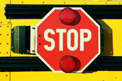 Red Stop Sign on Yellow School Bus. Close up of red stop sign on yellow school bus royalty free stock photo