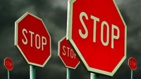 Red stop signs on the street. Roadside traffic signs for stopping with clouds time lapse footage in background. 1920x1080, 1080p, hd footage stock footage