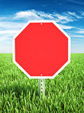 Red stop themed sign placed in a field of grass with room for text or copy space. Stock Images