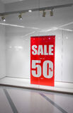 Red store discount sign on a shop window . Royalty Free Stock Photography