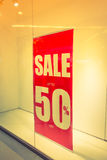 Red store discount sign on a shop window . ( Filtered image proc Royalty Free Stock Image