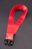 Red strap on the black background Stock Photos