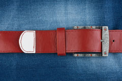 Red strap is on denim Stock Photo
