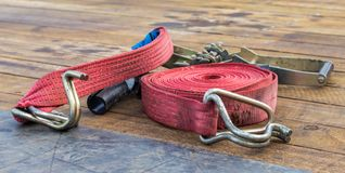 Red Strap and Ratchet. On a truck deck royalty free stock images