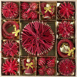 Red straw Christmas ornaments. Box with various handmade straw Christmas ornaments Stock Images