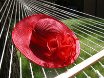 Red Straw Hat on Hammock Stock Images