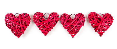 Red straw hearts. Isolated on white stock photos