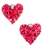 Red straw hearts. Isolated on white stock images