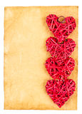 Red straw hearts on old paper Stock Photography