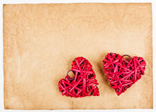 Red straw hearts on old paper Royalty Free Stock Photo