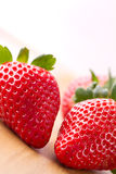 Red strawberries. Closeup of ripe strawberries on wooden background Royalty Free Stock Photo