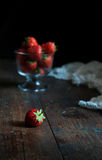 Red strawberries. Some fresh red strawberries on the desk Royalty Free Stock Photography