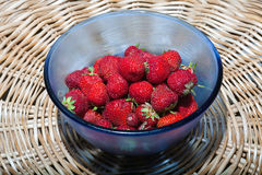 Red strawberries in a blue plate Royalty Free Stock Photography