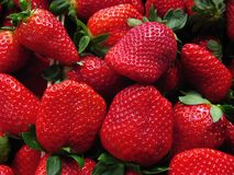 Red strawberries bunch. In a close up shot taken at the market (La Boqueria, Barcelona Royalty Free Stock Images