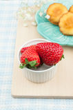 Red strawberries and cakes. Some fresh red strawberries and some little cakes Stock Photography