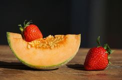Red Strawberries and Cantaloupe royalty free stock photos