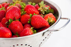 Red strawberries on a colander. Fresh red strawberries  on a colander on white background Royalty Free Stock Photo