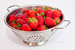 Red strawberries on a colander. Fresh red strawberries  on a colander on white background Stock Photos