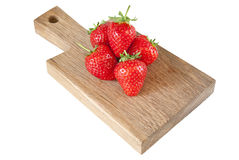 Red strawberries on a desk. Some fresh strawberries on a wooden desk Stock Photos