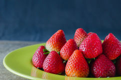 Red strawberries on dish Royalty Free Stock Images