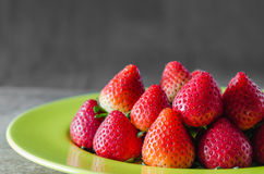 Red strawberries on dish Royalty Free Stock Photography