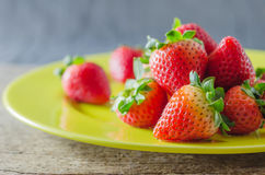 Red strawberries on dish Royalty Free Stock Photos
