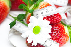 Red strawberries,flower and measure tape Stock Photography