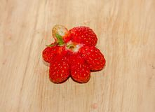 Red strawberries fruits, rustic wood background, close up.  Royalty Free Stock Photos