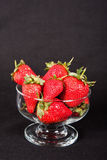 Red strawberries in a glass bowl Royalty Free Stock Images