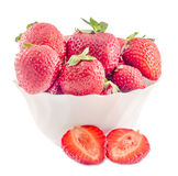 Red strawberries with green leaves in a white bowl, isolated Stock Photos