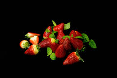Red strawberries isolated on black bakground. Royalty Free Stock Image