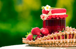 Red strawberries and jam in the basket Stock Photo