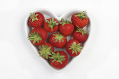Red Strawberries in a love heart shaped dish Royalty Free Stock Photos