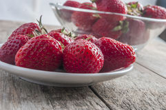Red strawberries on old wood table Royalty Free Stock Photos